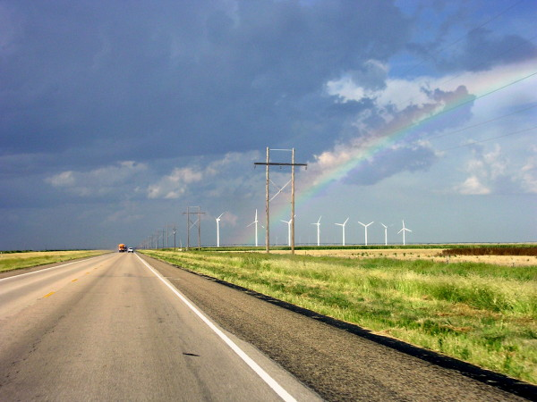 a long road, windmills and a rainbow