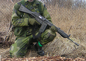 Soldier demonstrating gun safety by keeping th...