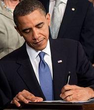 Obama_signs_health_care-crop