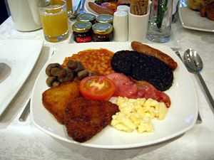 A full English breakfast with scrambled eggs, ...