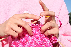 300px-Pink_knitting_in_front_of_pink_sweatshirt